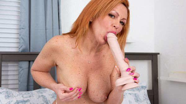 A MILF and her huge toy