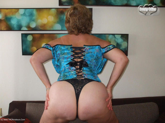 Teal Corset Showing Off That Arse